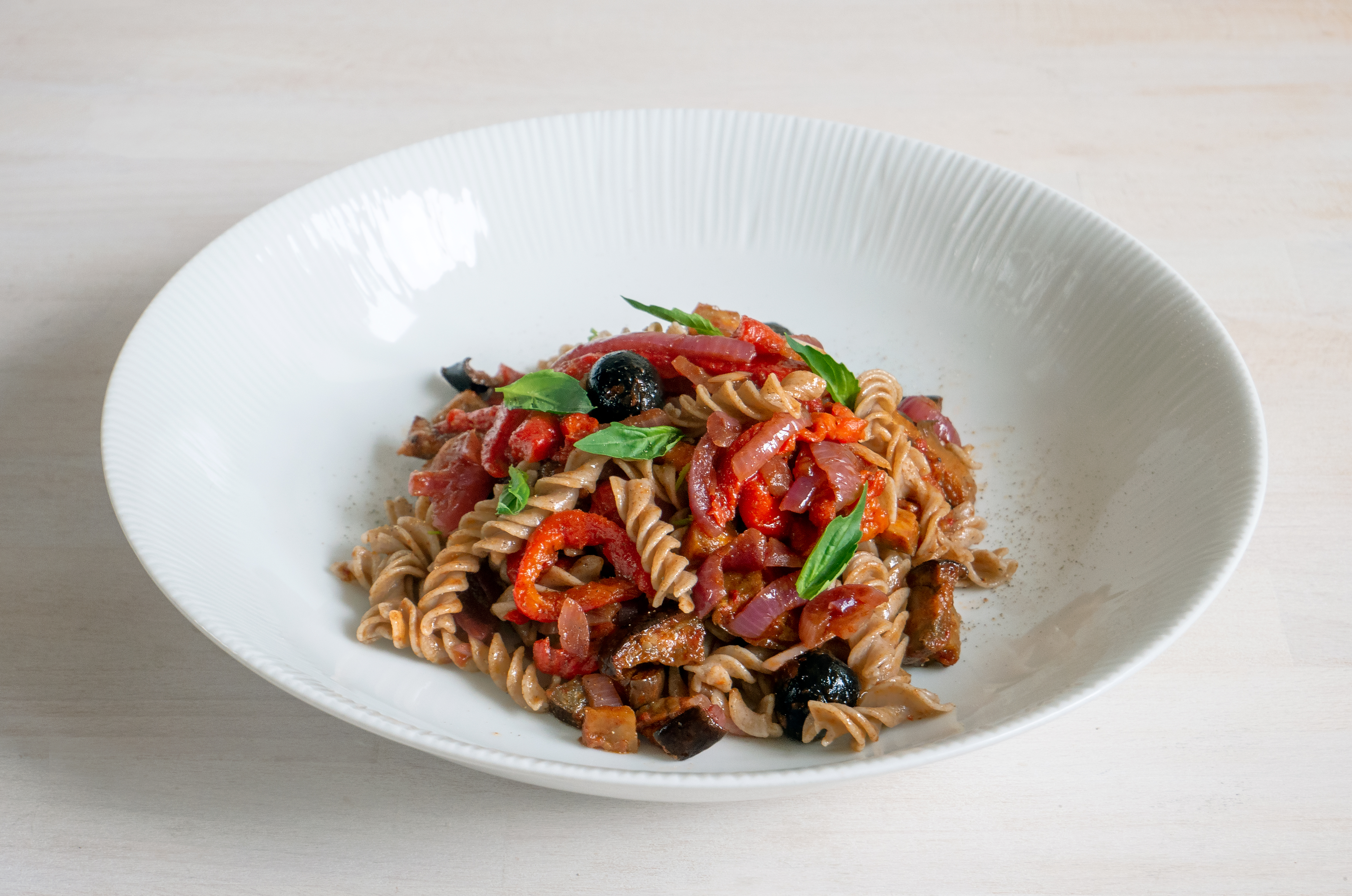 Recipe: Pasta with peppers, olives and spiced aubergine