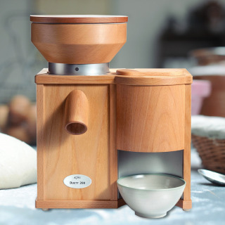 The KoMo Duett combines both a grain mill and an electric flaker into one unit. Housed in beech